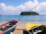 tropical beach scene, boats on beach